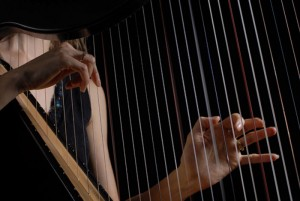 Hands on Harp Strings