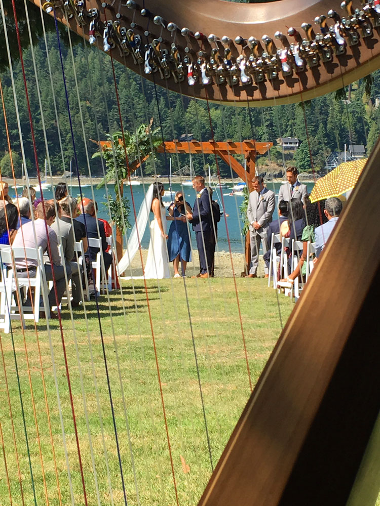 Harpist for wedding ceremonies - waterfront setting